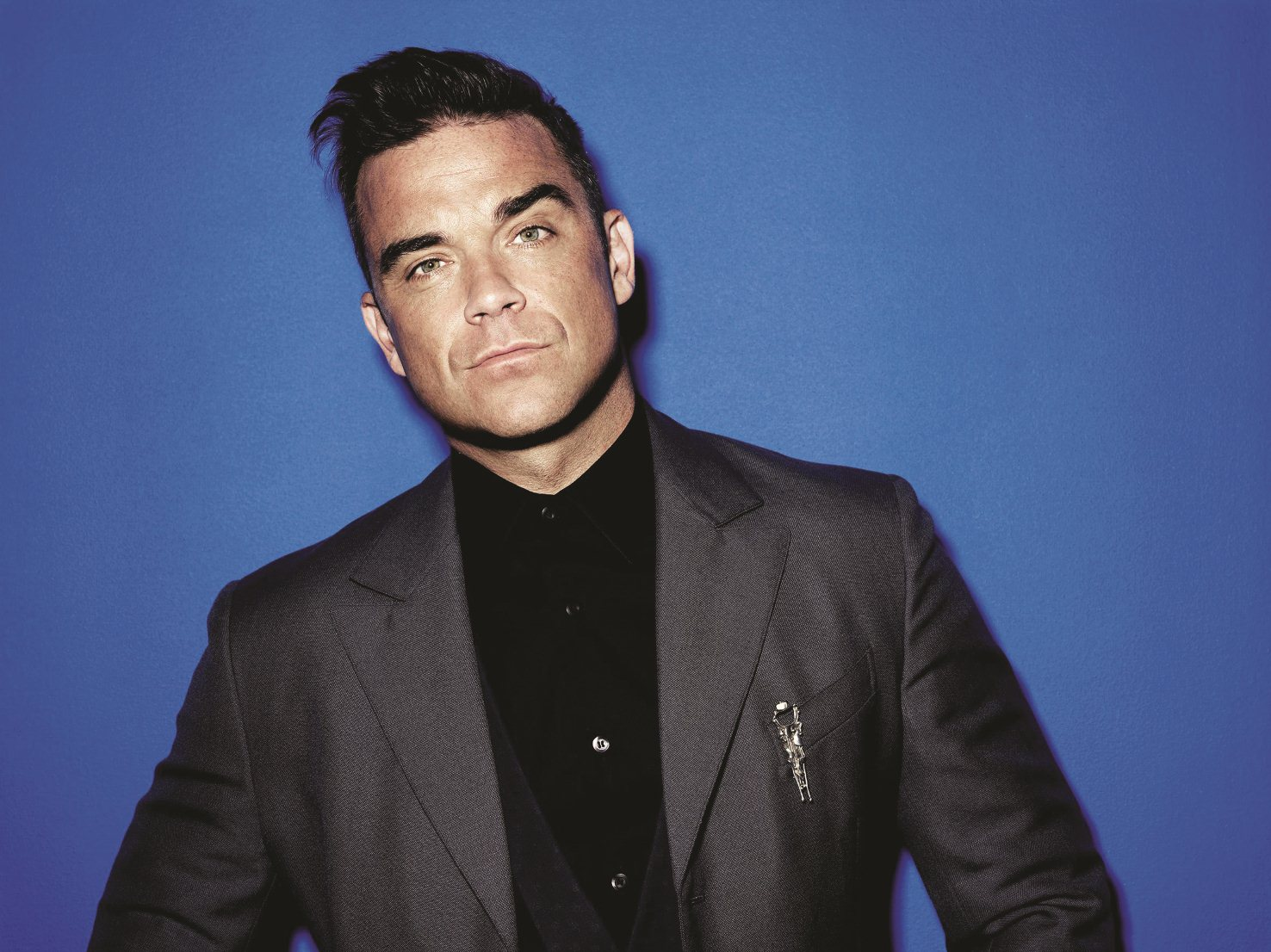 Robbie Williams reignites feud with Liam Gallagher while onstage in Las Vegas